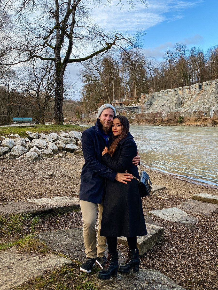 couple standing by the river in Bern