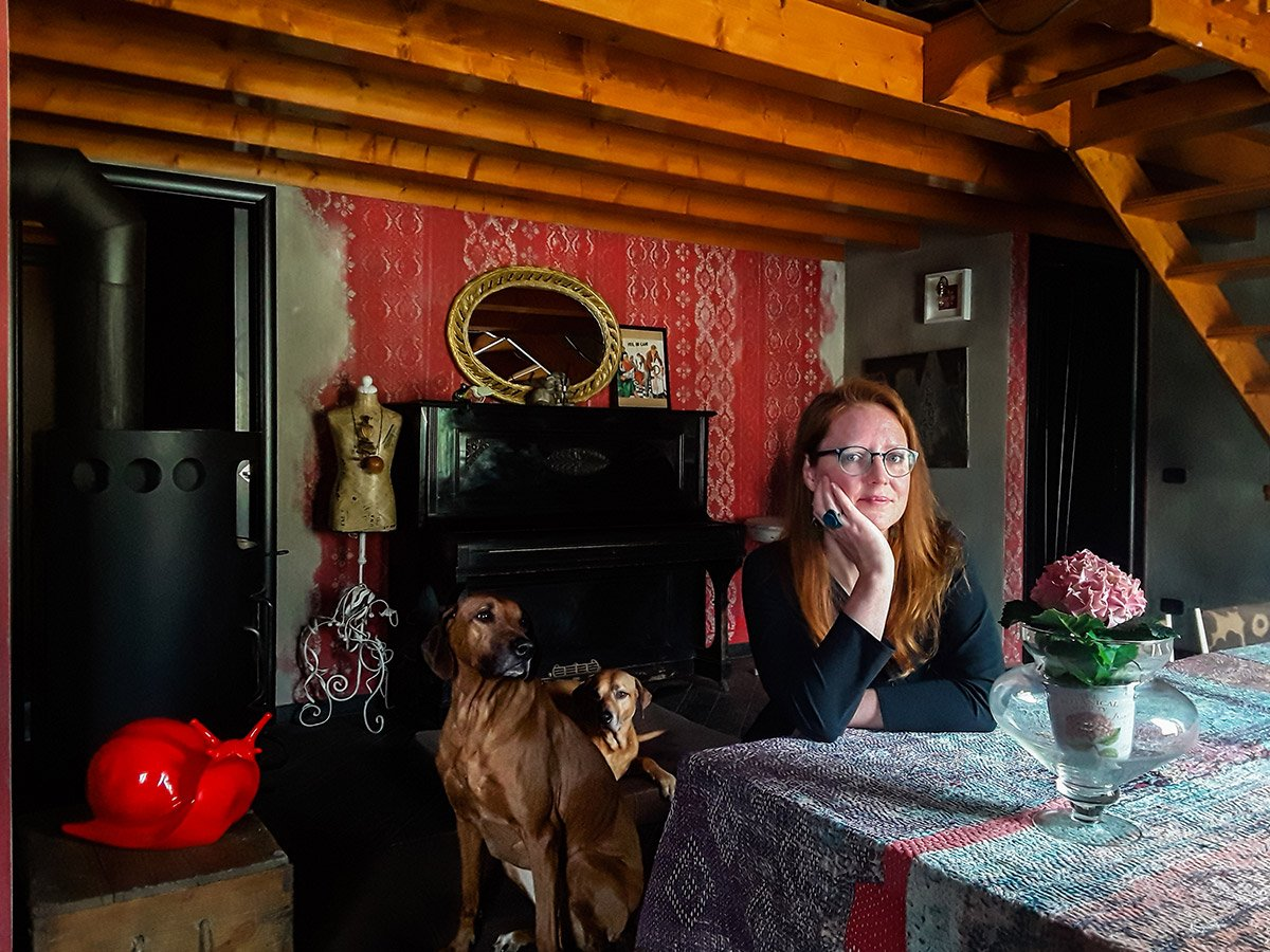 Woman in a red room with dogs
