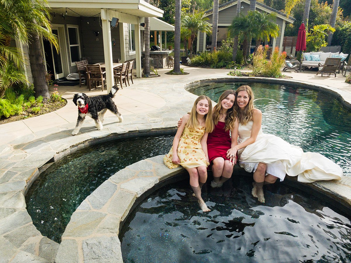 Online photo of a mother and her daughters sitting by the swimming pool in California