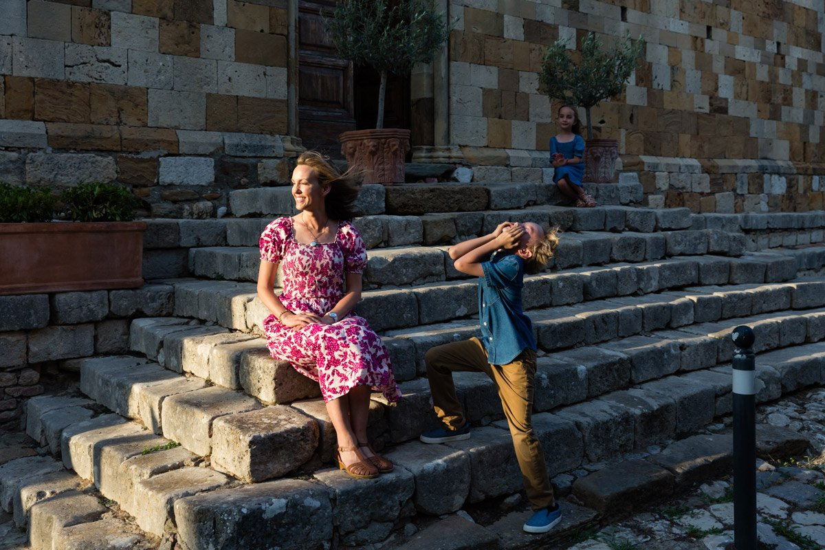 fun candid moment during a family photoshoot in Tuscany