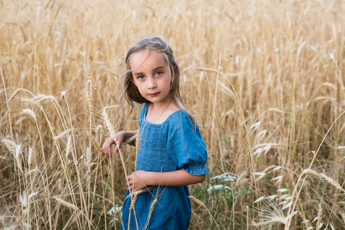 young girl portrait in a wheat field