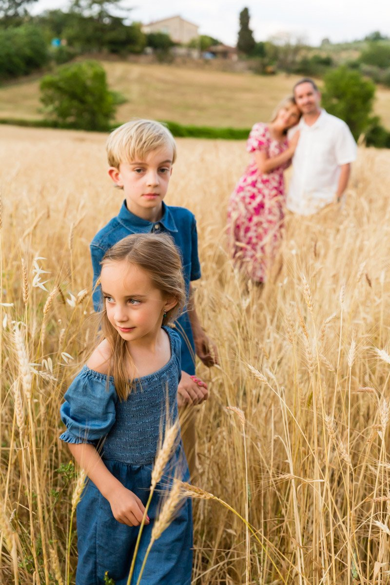 family portrait in a wheat field of Tuscany