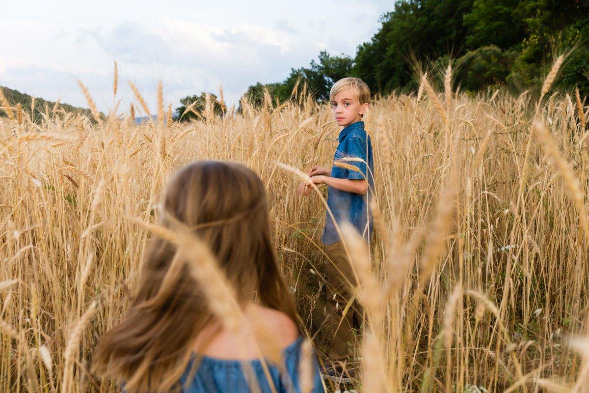 kids portrait in a wheat field of Tuscany