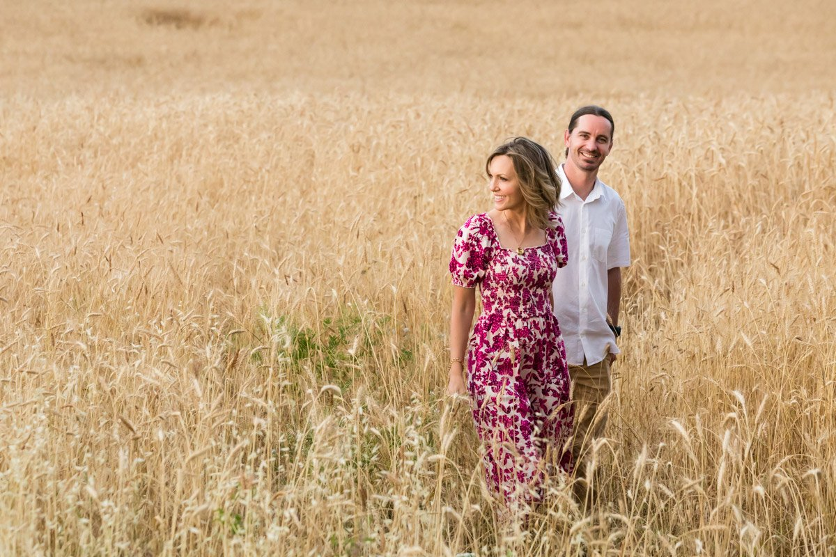 couple portrait in a wheat field of Tuscany
