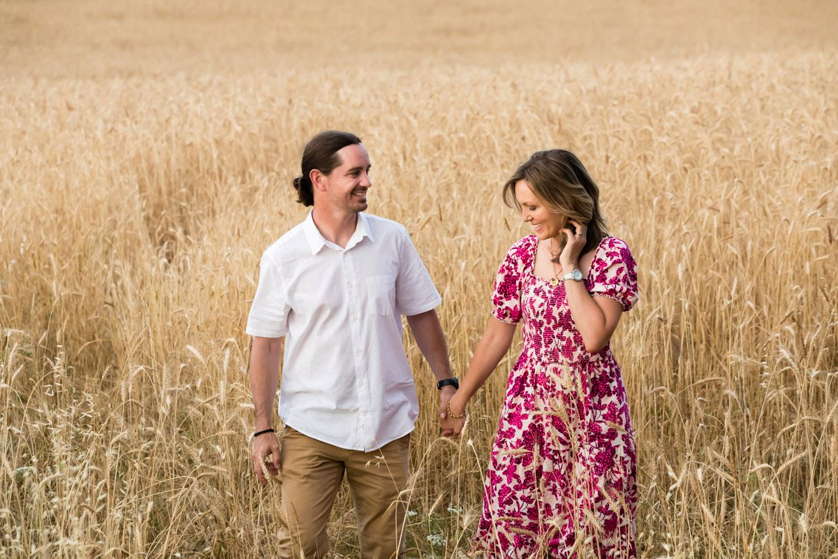 couple portrait on holiday in a wheat field