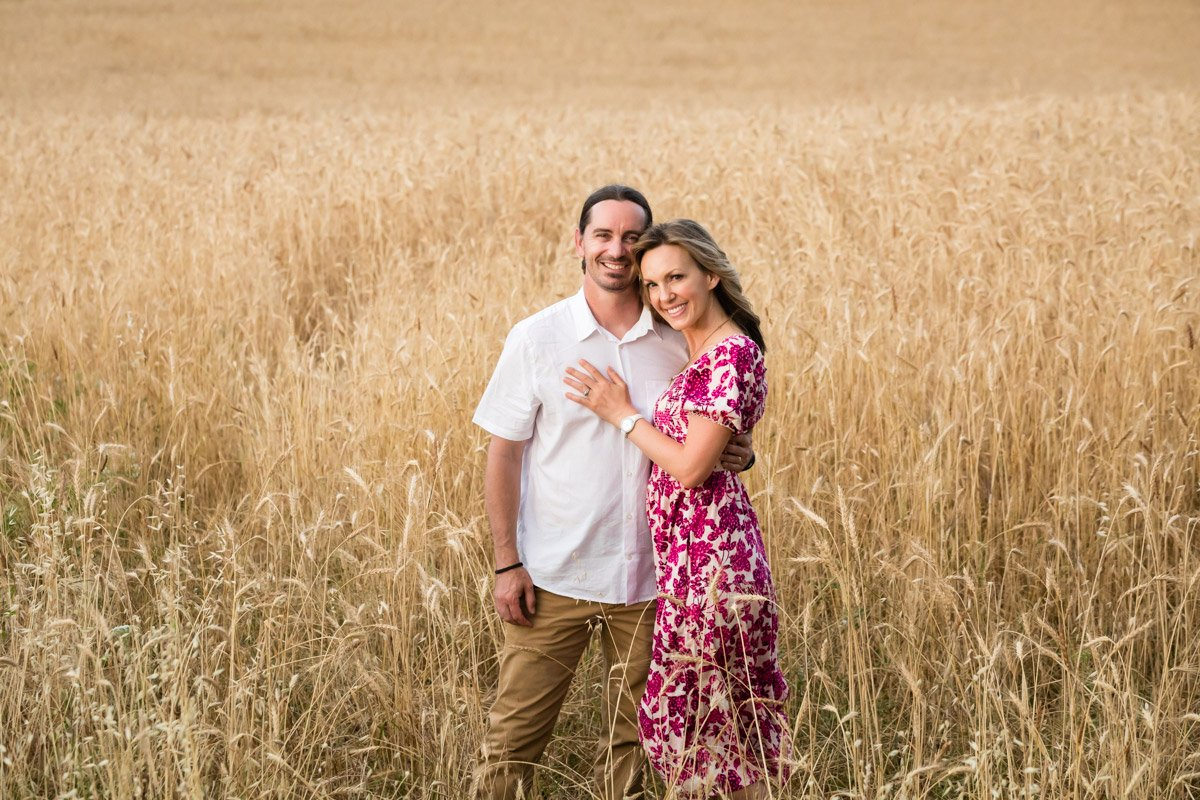 couple portrait on vacation in a wheat field