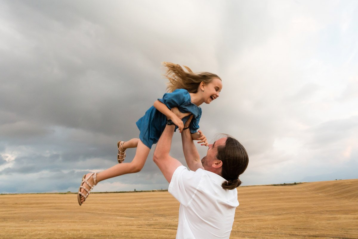 father and daughter having fun on holiday in Tuscany