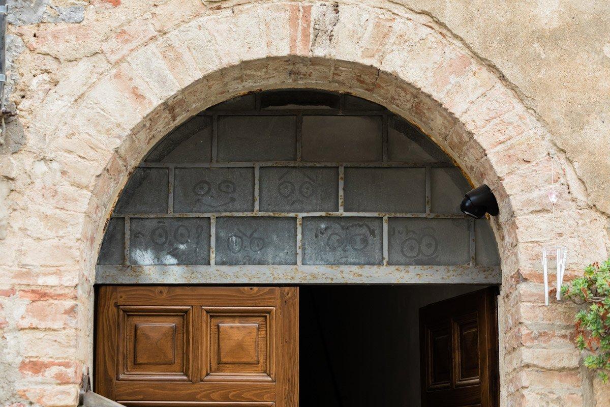window smileys in the streets of Montefollonico