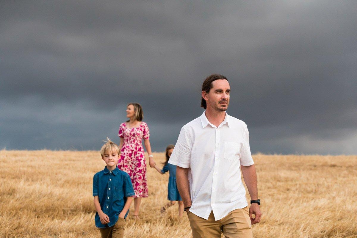 family portrait with dark sky in Tuscany
